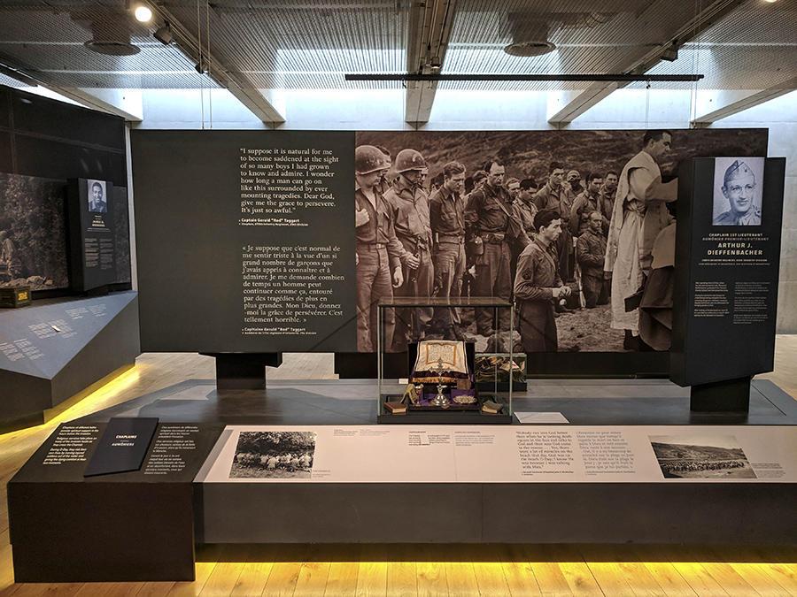 Cube showcase over religious object on podium