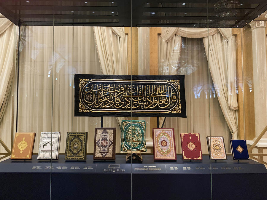 Free standing museum display case with religious books